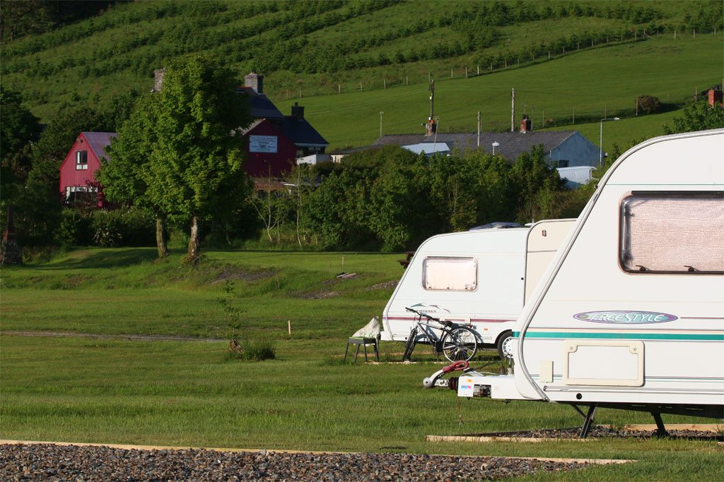 Caravans with Tafarn Sinc in the background